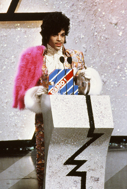 American singer, songwriter and musician Prince collects the award for Best International Artist at the British Record Industry Awards, aka the BRIT Awards, held at the Grosvenor House Hotel in London, 11th February 1985. (Photo by Georges De Keerle/Getty Images)