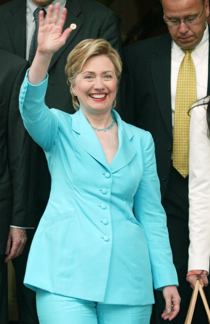 """Former US first lady Hillary Clinton waves as she leaves her hotel in Paris 02 July 2003. Hillary Clinton is in Paris to promote her memoir """"Living History"""". AFP PHOTO PIERRE VERDY (Photo credit should read PIERRE VERDY/AFP/Getty Images)"""