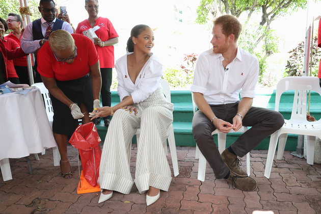 BRIDGETOWN, BARBADOS - DECEMBER 01:  Prince Harry (R) watches as  Singer Rihanna (L) gets her blood sample taken for an live HIV test, in order to promote more widespread testing for the public at the 'Man Aware' event held by the Barbados National HIV/AIDS Commission on the eleventh day of an official visit on December 1, 2016 in Bridgetown, Barbados.  Prince Harry's visit to The Caribbean marks the 35th Anniversary of Independence in Antigua and Barbuda and the 50th Anniversary of Independence in Barbados and Guyana.  (Photo by Chris Jackson - Pool/Getty Images)